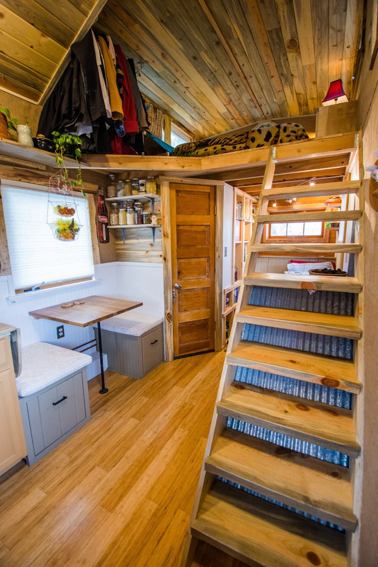 The Stairs Angled Door And Loft All Make This Woodsy Tiny House Cozy