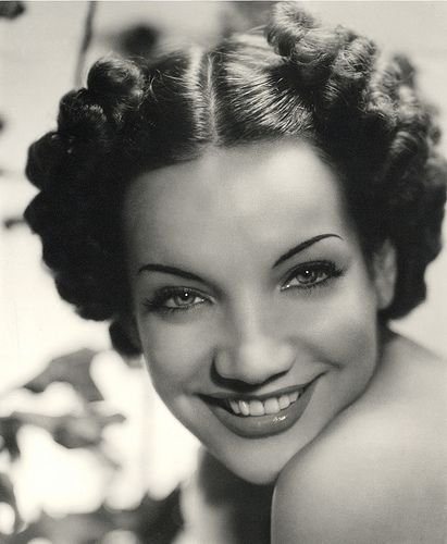 A Young Carmen Miranda  She was a spitfire.  Loved  her hats with all the fruit on them.  She was 4ft9in.