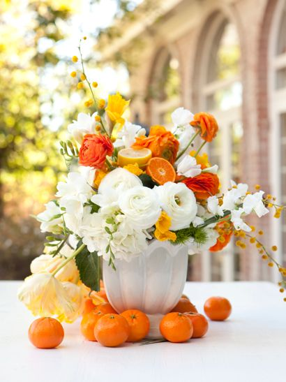 I usually hate orange, but I can't help but love this. / love the combo of oranges and flowers.  so summery.