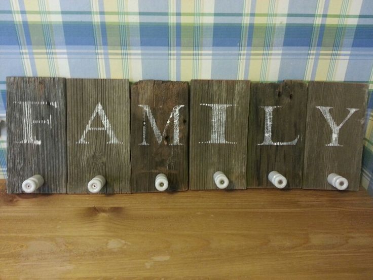 Family wall mount coat hangers, there's enough for everyone. Supplies are barn wood, electric fence insulators and some paint.