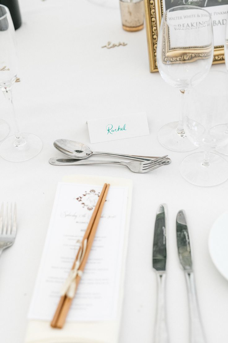 A wedding menu with couple's logo in gold and mint. Created by #novaweddingplanning
