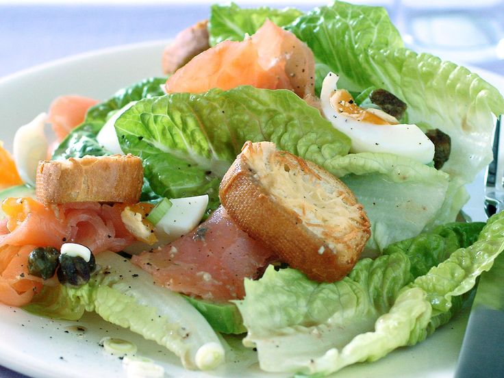 Switch your bacon for delicate, flaky smoked salmon and delight your dinner guests with this beautiful caesar salad. Topped with crunchy golden, soft-boiled eggs and a creamy, tangy sauce, this dish is a real family favourite.
