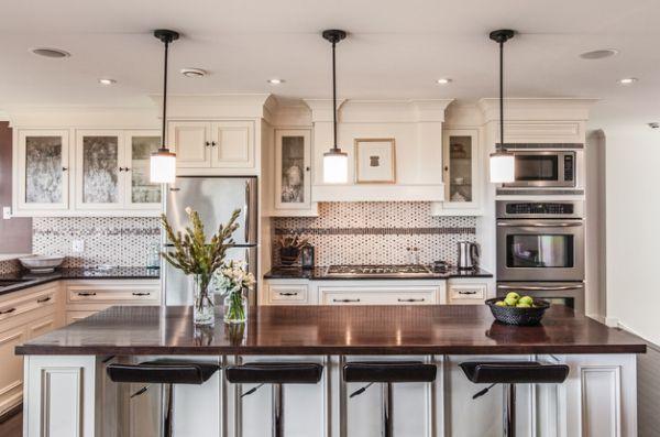 Pendant Lighting Over Kitchen Island   Dazzling pendant lights above a white kitchen island with dark granite ...