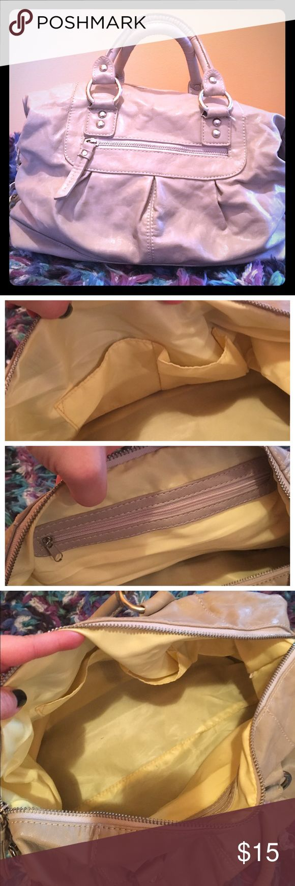 Francesca's Mini Purse 👜 Cute beige bag, that can carry it all. Outside zipper just big enough to put your keys. Inside has zipper pouch and 2 pouches for phone. Small pen stain on interior shown in last picture. Francesca's Collections Bags Hobos