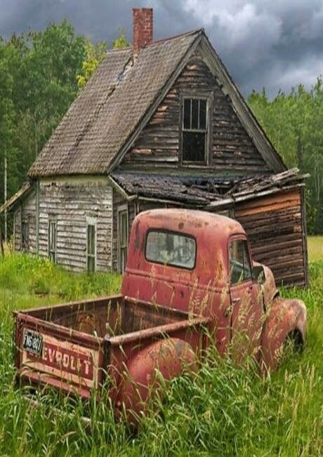 Abandoned old cabin and truck