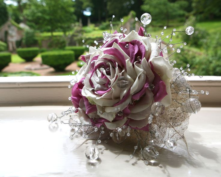 Purple and white corsage wedding flowers. Langdon Court Devon Wedding Venue.   #weddingflowers #corsage #roses #purpleflowers #whiteflowers #whitewedding #weddingideas #weddinginspo