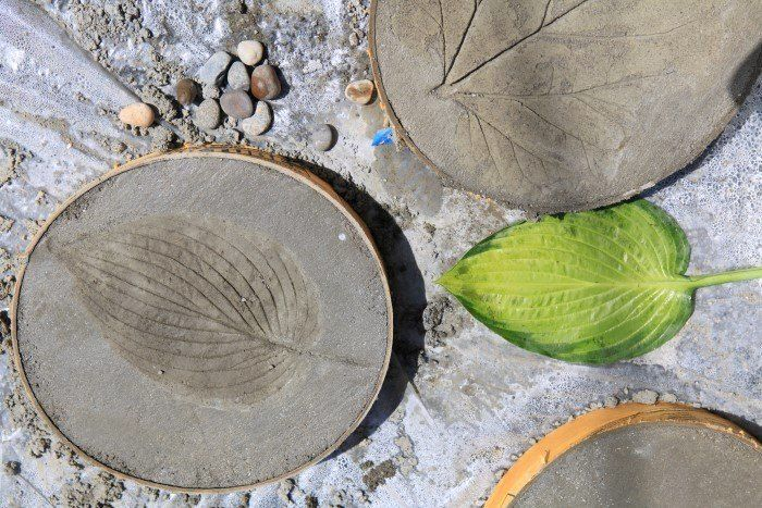 Leaf-Print Concrete Stepping Stones | Hometalk... make a lot, they cost less than 2 bucks a piece to make.