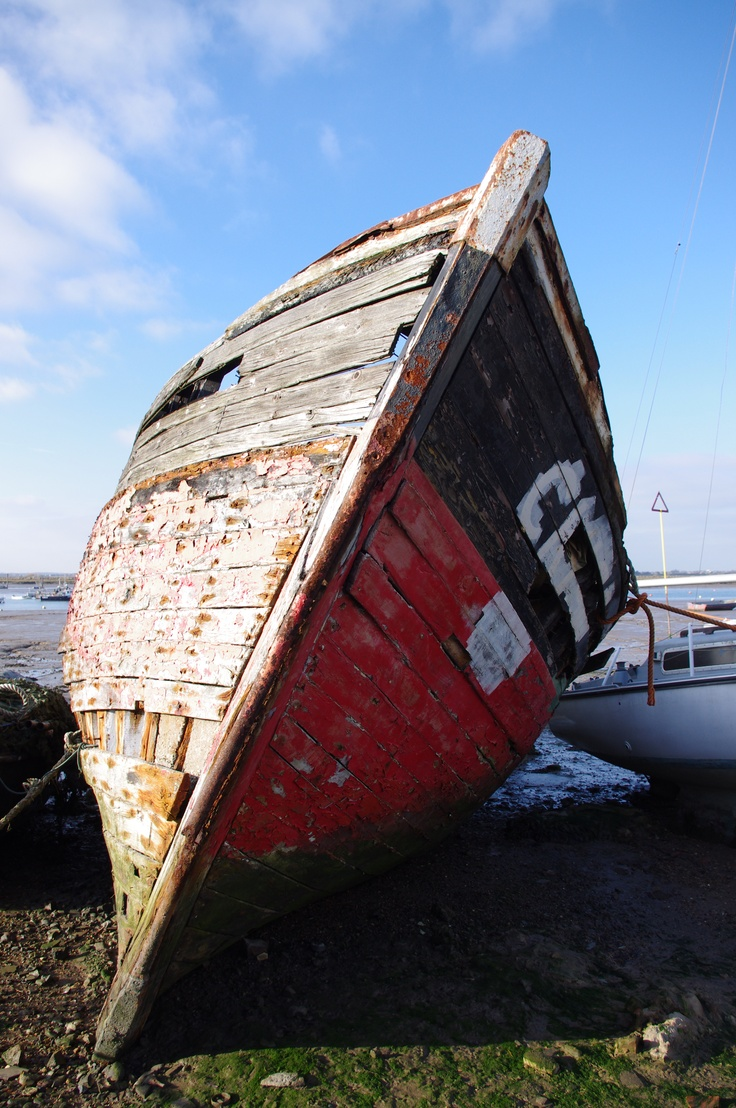 A broken fishing boat on the hard at Mersea Island, Essex. Excellent fish and chips then a walk with the camera. A perfect day out...