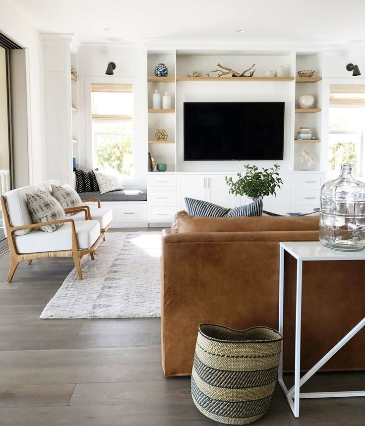 White built in bookcases tv surround, natural wood touches