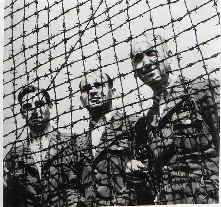 Dutch officers in Amersfoort concentration camp.  Left to right: J.A.M. van Doorn, J. Schols and H.J. van Thiel.