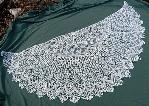 White lace shawl, I made this for my coworker Carol and it took me almost the entire summer, but it turned out beautifully!