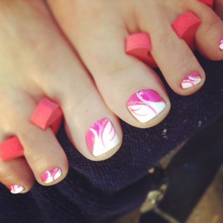 Pink and white swirls on toenails