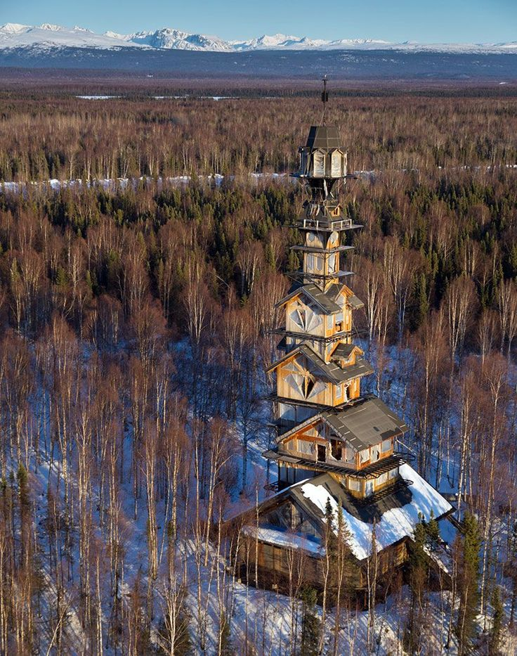 phillip weidner, an attorney in anchorage, alaska, has been building his 'goose creek tower' in the mountainous landscape of talkeetna for years.