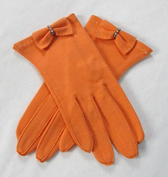 Orange gloves with bow.