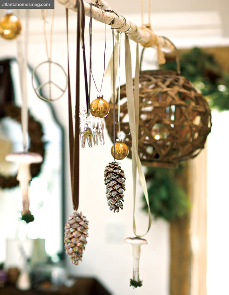 """Most people would put them in a bowl or on the tree, but I chose to isolate them as special, beautiful objects,"" says Brinson of Kasler's pinecones, hanging alongside other keepsakes on a branch."
