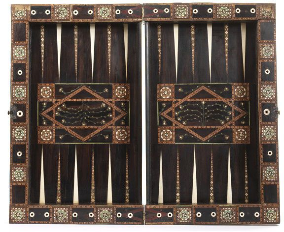 Backgammon Game Board, 1525. Granada Spain. Restored, probably during the 18th century (based on fragments of paper from an 18th century dictionary used in re-glueing loose veneers), and again more recently when the shaped inner edgings to the backgammon boards were replaced.