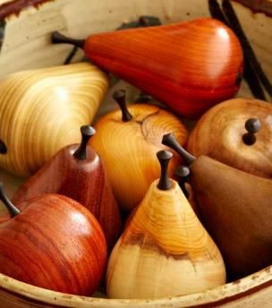 Made by an English artisan, our selection of fruits are turned and finished entirely by hand and protected with a natural wax polish. The stems are made from African Ebony and the fruitwood is sourced ethically from all over the world. A handsome edition for display on a desk, bookshelf or coffee table.  Please call us if you have a preference for a particular wood.