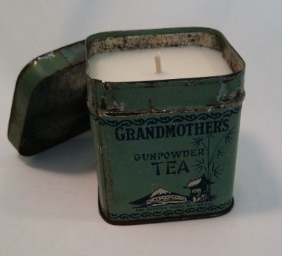 Candle in antique tea tin. LOVE  www.antiquecandleworks.com