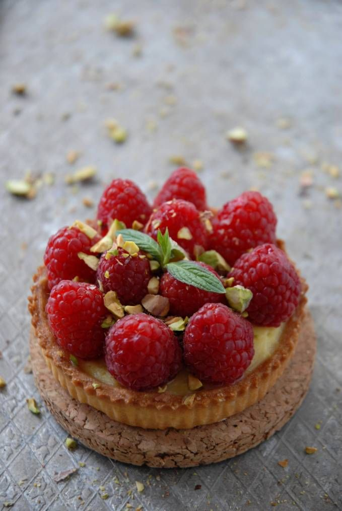 Raspberry and pistachio tartelette with vanilla pastry cream and a thin layer of white chocolate