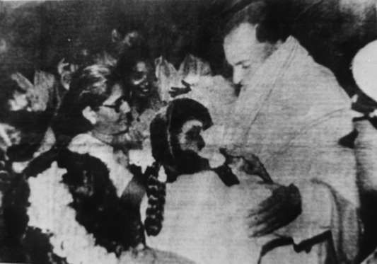 May 21, 1991 -- The file photo shows Rajiv Gandhi being greeted as he arrives to make an address during his election campaign moments before he was killed by a suicide bomber in Sriperumbudur, Tamil Nadu State. The Tamil guerrilla assassin is in the bottom left corner with flowers on her head.