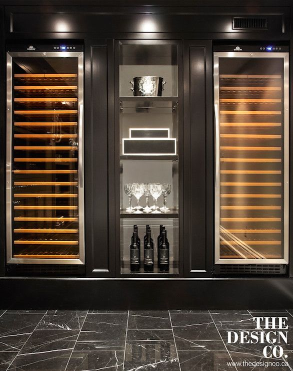 Basement with wine cellar features matching glass-front wine coolers,  temperature controlled wine fridges