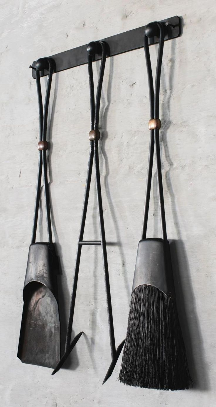 JENS QUISTGAARD | A Rare Set of Fireplace Tools, comprising shovel, poker, brush and wall mount