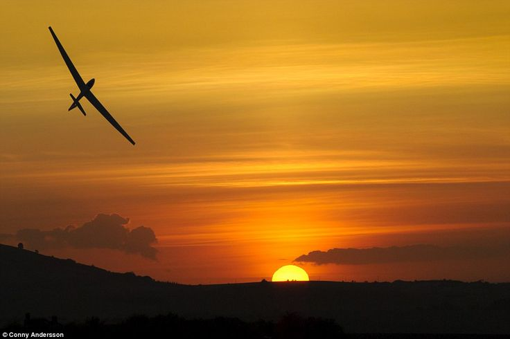 Rising over sunset: A glider climbs above the horizon line over Ivinghoe in Buckinghamshir...