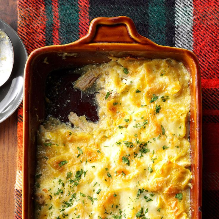 Chicken Enchilada Bake Recipe -Your family is going to gobble up this cheesy, Southwestern chicken bakeand will ask for it again and again. It's real…