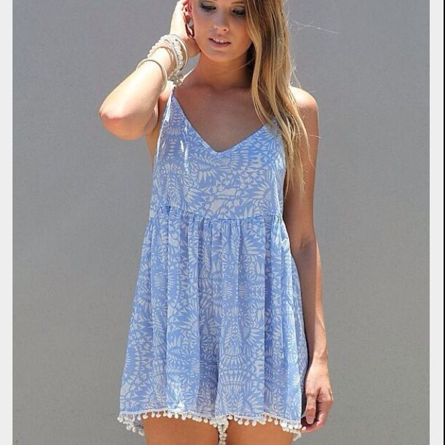 blue, white playsuit with pom poms