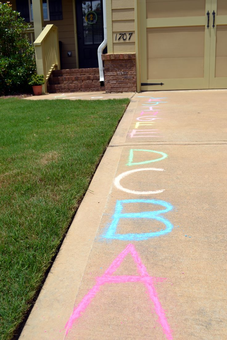 Alphabet party -- chalked ABC on walkway leading into house