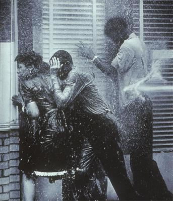Black civil rights demonstrators attacked by police water hose. Birmingham, Alabama May 1963.
