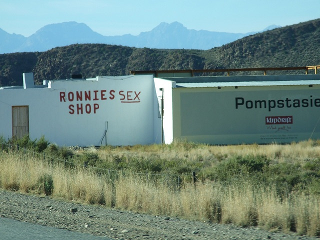 Ronnie's Sex Shop. Only a sexshop by name. It is a cafe along Route 62 in South Africa. It used to be just Ronnies Shop, but some friends of Ronnie tried to be funny and painted Sex on the wall, so it became Ronnies Sex Shop.