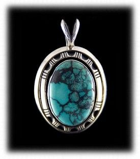 This is a Navajo Handcrafted Turquoise Pendant that is iconic for modern Native American Turquoise Jewelry