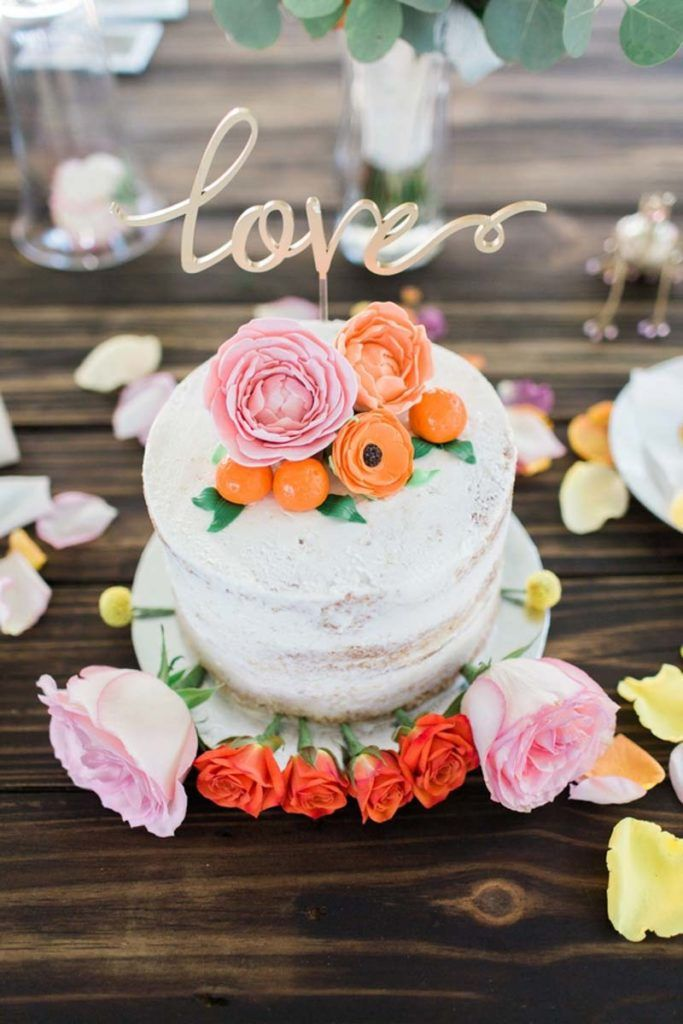 White Buttercream Cake with Love Cake Topper from Little Blessings and Bakery - Boho Inspired Wedding - Photo by Harmony Lynn Photography - Rossetter House and Museum in Melbourne, FL - click pin for more - www.orangeblossombride.com