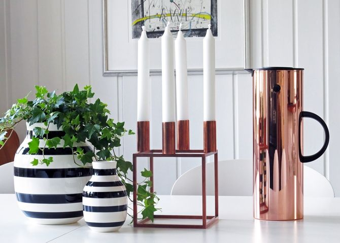 Stelton Vacuum jug, a timeless classic and the iconic Kubus candlesticks. Both in beautiful copper