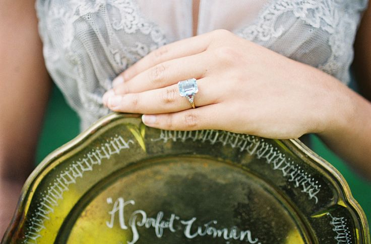 Glam + aquamarine: http://www.stylemepretty.com/2015/10/11/25-colored-engagement-rings-to-covet/
