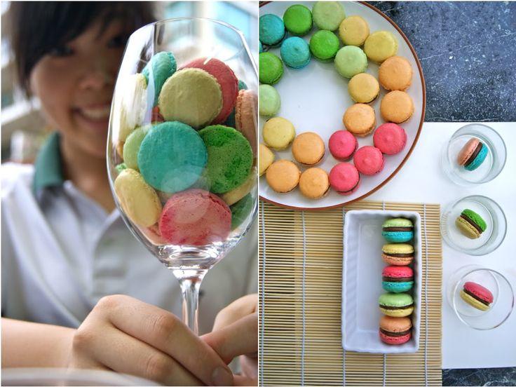 Rainbow macarons inside wine glass