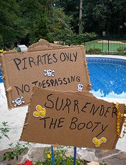 Pirate Decorations Using Pirate Hats, Swords and Inflatables