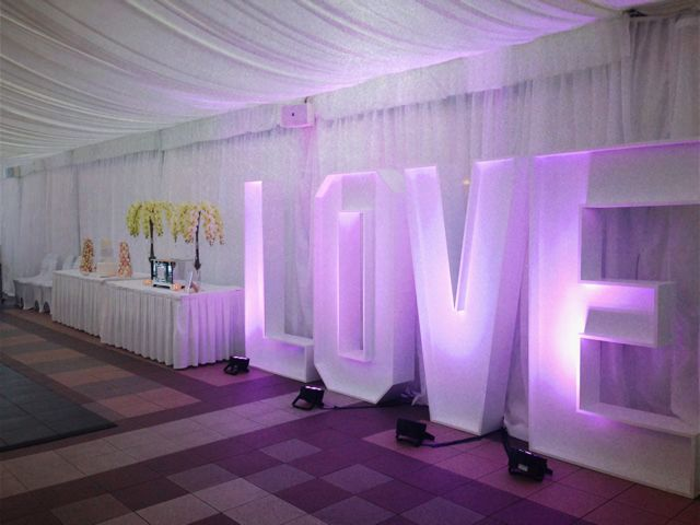 It is all about LOVE - amazing LOVE sign was a focus point of this Marquee wedding.