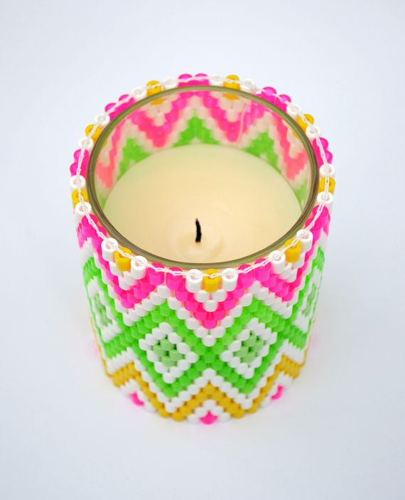 Candle holder woven from Hama beads (those little hollow beads that kids arrange on that little pegboard and then iron to fuse them together)