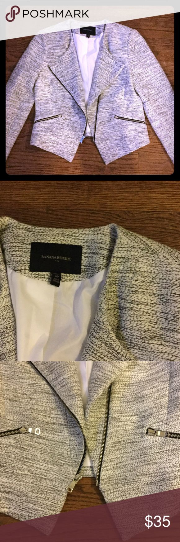 Banana Republic cropped Blazer Tweed black and white cropped Blazer. Slightly longer in front. Great structure in shoulder area. Useable front pockets. Fully lined. Same zipper detailing on sleeves. Has a moto vibe to it. Banana Republic Jackets & Coats Blazers