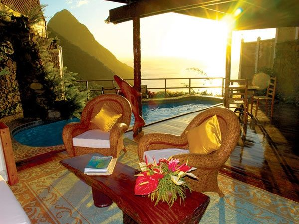 Ladera, St Lucia: This hotel has it's rooms built into a hillside, and has a to-kill-for view. But the view is not it; it also has an amazing open-air wedding pavilion, 23 suites, nine villas, and a tropical spa.Image via Ladera Source: Forbes