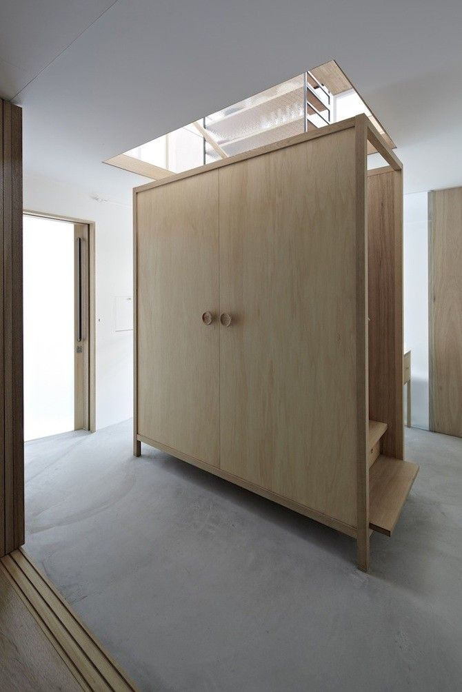 Itami House by Tato Architects, wood closet as stairs| Remodelista