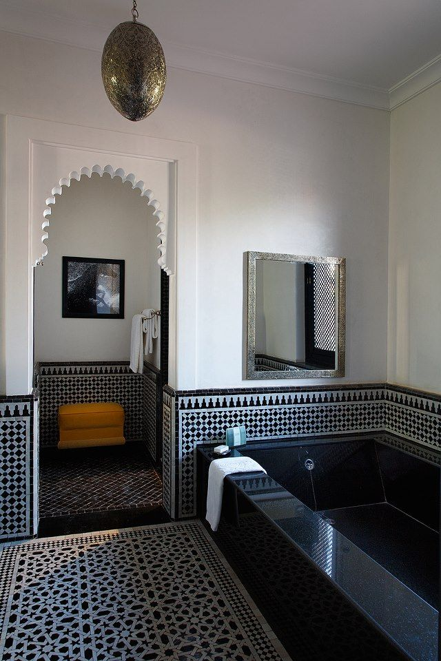 Intricate black and white tiles gives this Moroccan bathroom a modern twist.