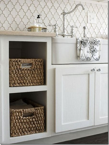 Moroccan tile back splash, baskets on open shelving & an apron sink. This would be great for a laundry room.