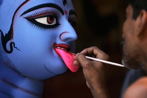 Artist in Calcutta works on a statue of Hindu Goddess Kali.