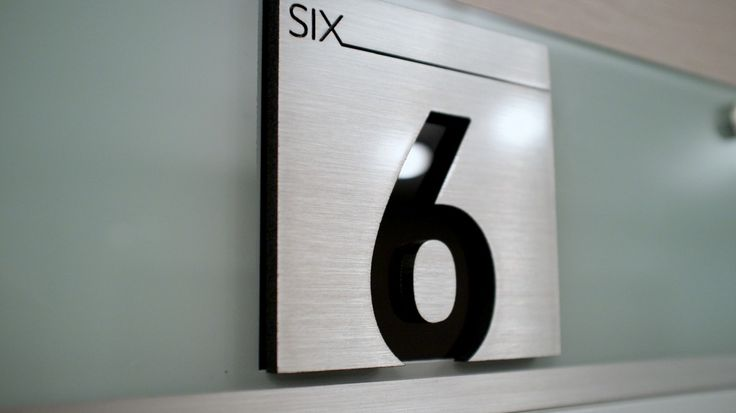 Aluminum plaque, part of the office signage program at Exchange Tower, Toronto, ON.