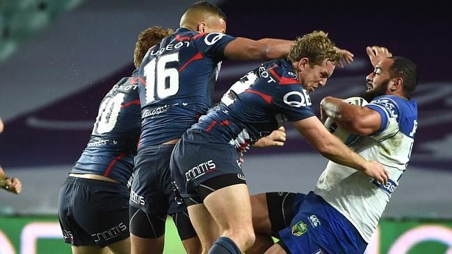 Kane Evans stop Sam Kasiano with a shoulder charge