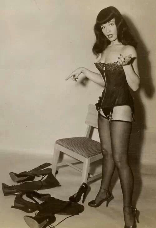 She didn't exactly understand why these men requested these type of shoes and boots, but she knew it made them happy, and she was happy todo so - Bettie Page