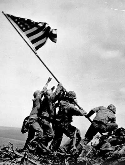 the raising of the flag on iwo jima, taken during the battle of iwo jima by joe rosenthal. the picture depicts the marines and sailor who raised the second flag over iwo jima: sgt michael strank, cpl harlon block, pfc franklin sousley, pfc rene gagnon, pfc ira hayes, pm2 john bradley.